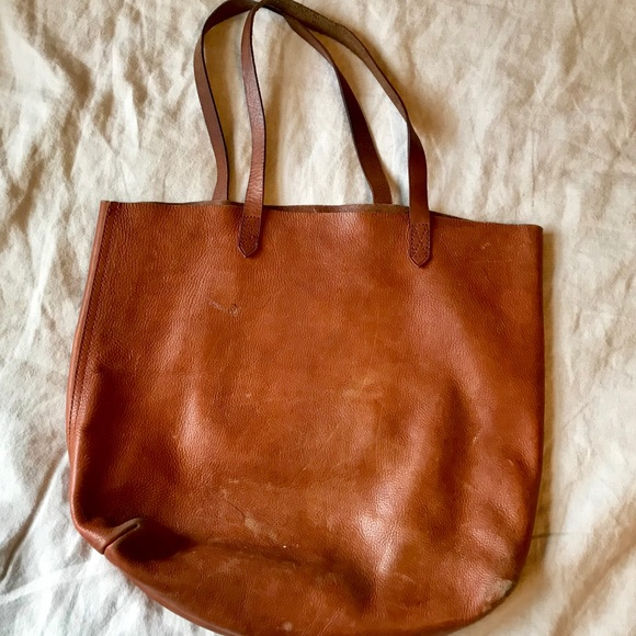 5a6fe6ac3a46 Madewell Transport Leather Tote. Madewell. M_5c57445f619745ee2dde3773.  M_5c5744618ad2f95cd812403a. M_5c574463409c1504d321bde7.  M_5c57446534a4ef6cdd67acab